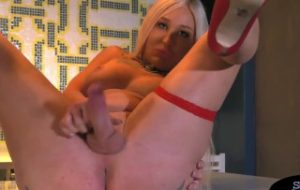 Busty blonde shemale tugs and shows off booty