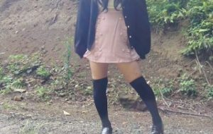 Japanese crossdresser pees openly in the forest for a selfie.
